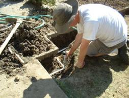 Scottsdale sprinkler repair specialist replaces an underground line and pop up head